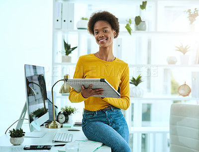Buy stock photo Portrait of a young designer working on a digital tablet in an office