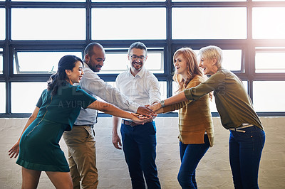 Buy stock photo Cropped shot of a group of colleagues joining their hands in solidarity at work