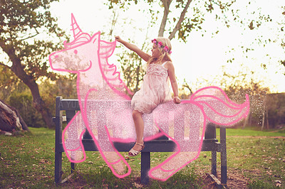 Buy stock photo Shot an adorable little girl riding a pink toy unicorn outdoors
