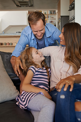 Buy stock photo Shot of a little girl bonding with her parents at home