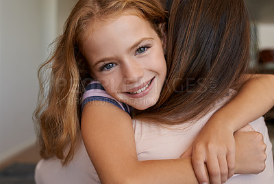 Buy stock photo Portrait of a little girl hugging her mother at home