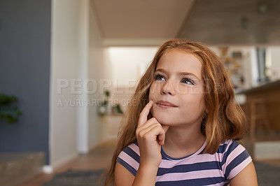 Buy stock photo Shot of an adorable little girl looking thoughtful at home