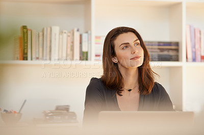 Buy stock photo Shot of a young woman using a laptop and looking thoughtful while working from home