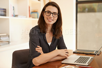 Buy stock photo Shot of a confident young woman working from home
