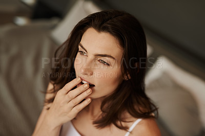 Buy stock photo Shot of a beautiful young woman waking up in bed and yawning