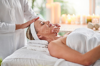 Buy stock photo Shot of a mature woman getting a facial treatment at a spa