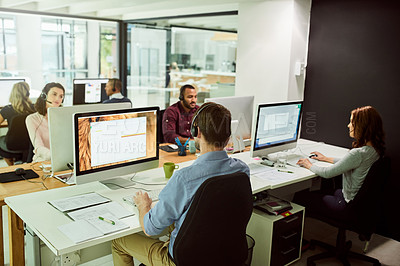 Buy stock photo Cropped shot of call center agents working in an open office space