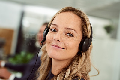 Buy stock photo Shot of a call center agent working in an office
