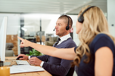 Buy stock photo Shot of call center agents working in an office