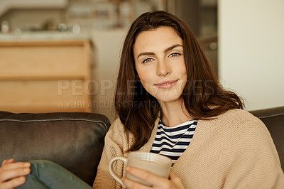 Buy stock photo Portrait of a beautiful young woman relaxing with a cup of coffee at home