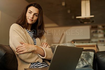 Buy stock photo Portrait of a beautiful young woman using a laptop at home