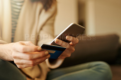 Buy stock photo Closeup shot of a woman using a cellphone and credit card at home
