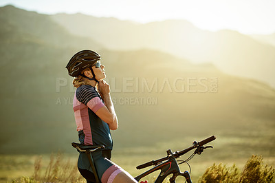 Buy stock photo Cropped shot of a sporty woman out cycling