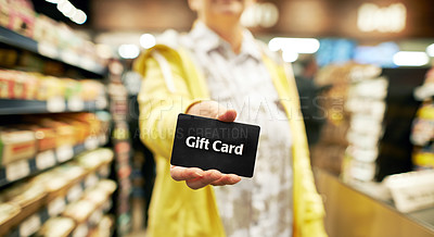 Buy stock photo Cropped shot of a woman using a gift card at a supermarket