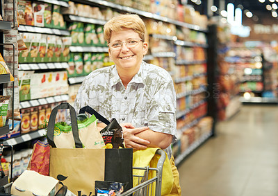 Buy stock photo Portrait of a mature woman shopping in a grocery store