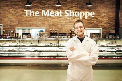 Buy stock photo Portrait of a young man working in the meat section of a grocery store
