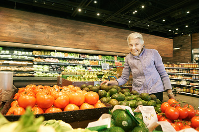 Buy stock photo Portrait of a senior woman shopping in a grocery store