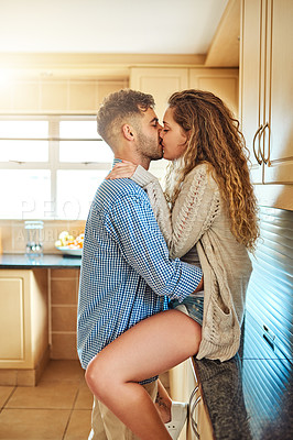 Buy stock photo Shot of an affectionate young couple sharing a romantic moment at home