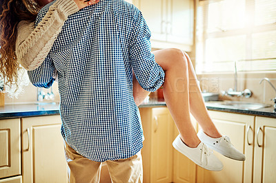 Buy stock photo Rearview shot of a young man carrying his girlfriend in their home