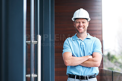 Buy stock photo Portrait of a cheerful engineer posing with his arms folded outside a building