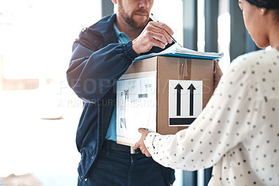 Buy stock photo Shot of an unrecognizable delivery man handing a package to a female customer