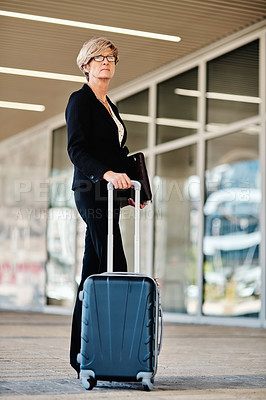 Buy stock photo Portrait of a mature businesswoman standing outside an airport