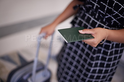 Buy stock photo Cropped shot of a businesswoman holding a passport in an airport