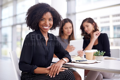Buy stock photo Portrait of a group of young businesswomen having a meeting in a modern office
