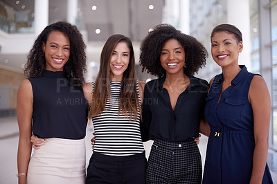 Buy stock photo Portrait of a group of young businesswomen working together in a modern office