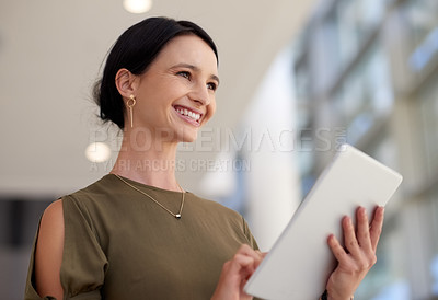 Buy stock photo Cropped shot of an attractive young businesswomen using her tablet in the office