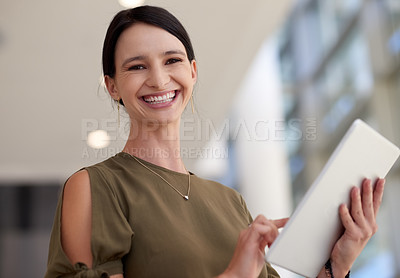 Buy stock photo Cropped portrait of an attractive young businesswomen using her tablet in the office