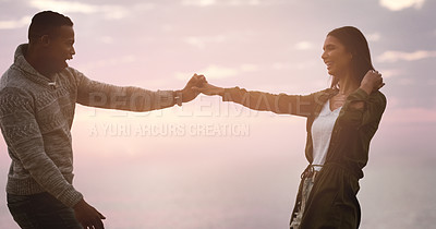 Buy stock photo Cropped shot of a happy young couple dancing together outdoors