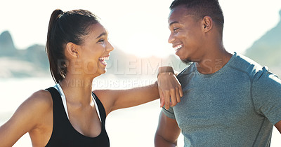 Buy stock photo Cropped shot of a happy young couple  out for a workout at the beach