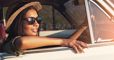 Buy stock photo Closeup shot of an attractive young woman enjoying a roadtrip on a sunny day