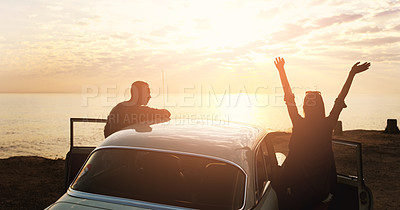 Buy stock photo Cropped shot of a young couple cheering at the beach while out on a road trip