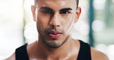 Buy stock photo Closeup portrait of a focused young sportsman posing in the gym