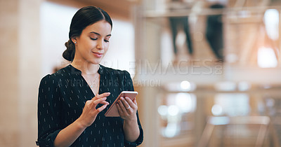 Buy stock photo Cropped shot of a young businesswoman using a mobile phone in a modern office