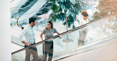Buy stock photo Cropped shot of businesspeople taking an escalator in the workplace