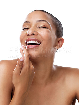 Buy stock photo Studio shot of a beautiful young woman touching her face while standing against a white background