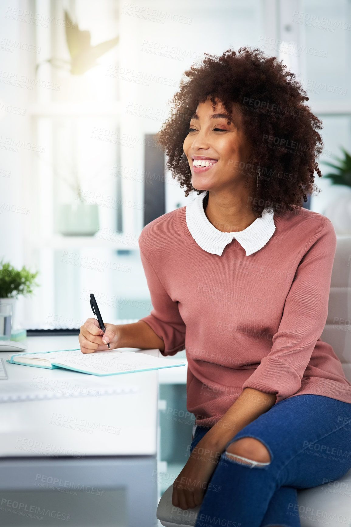 Buy stock photo Cropped shot of a beautiful young woman working in a modern office