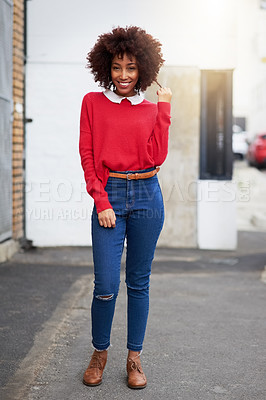 Buy stock photo Shot of a fashionable young woman out in the city