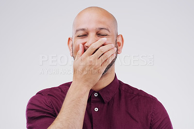 Buy stock photo Studio shot of a handsome young businessman laughing while standing against a grey background