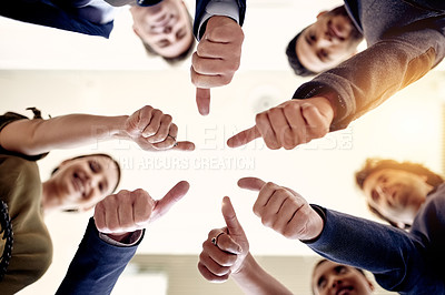 Buy stock photo Shot of a group of businesspeople showing thumbs up together