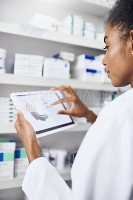 Buy stock photo Cropped shot of a pharmacist using a digital tablet in a chemist