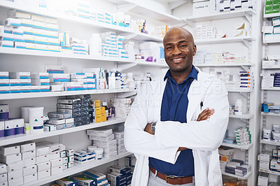 Buy stock photo Cropped shot of a confident man working as a pharmacist in a chemist
