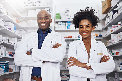 Buy stock photo Portrait of two pharmacist standing with their arms crossed