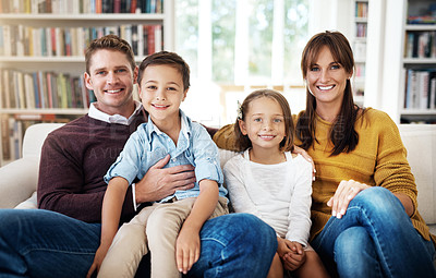 Buy stock photo Portrait shot of a happy family having a relaxing day at home