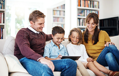 Buy stock photo Cropped shot of a family using a digital tablet together