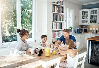 Buy stock photo Shot of a happy family having breakfast together at home