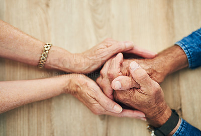 Buy stock photo Cropped shot of a senior couple holding hands